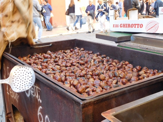Chestnuts roasting over a wood fire in Verona