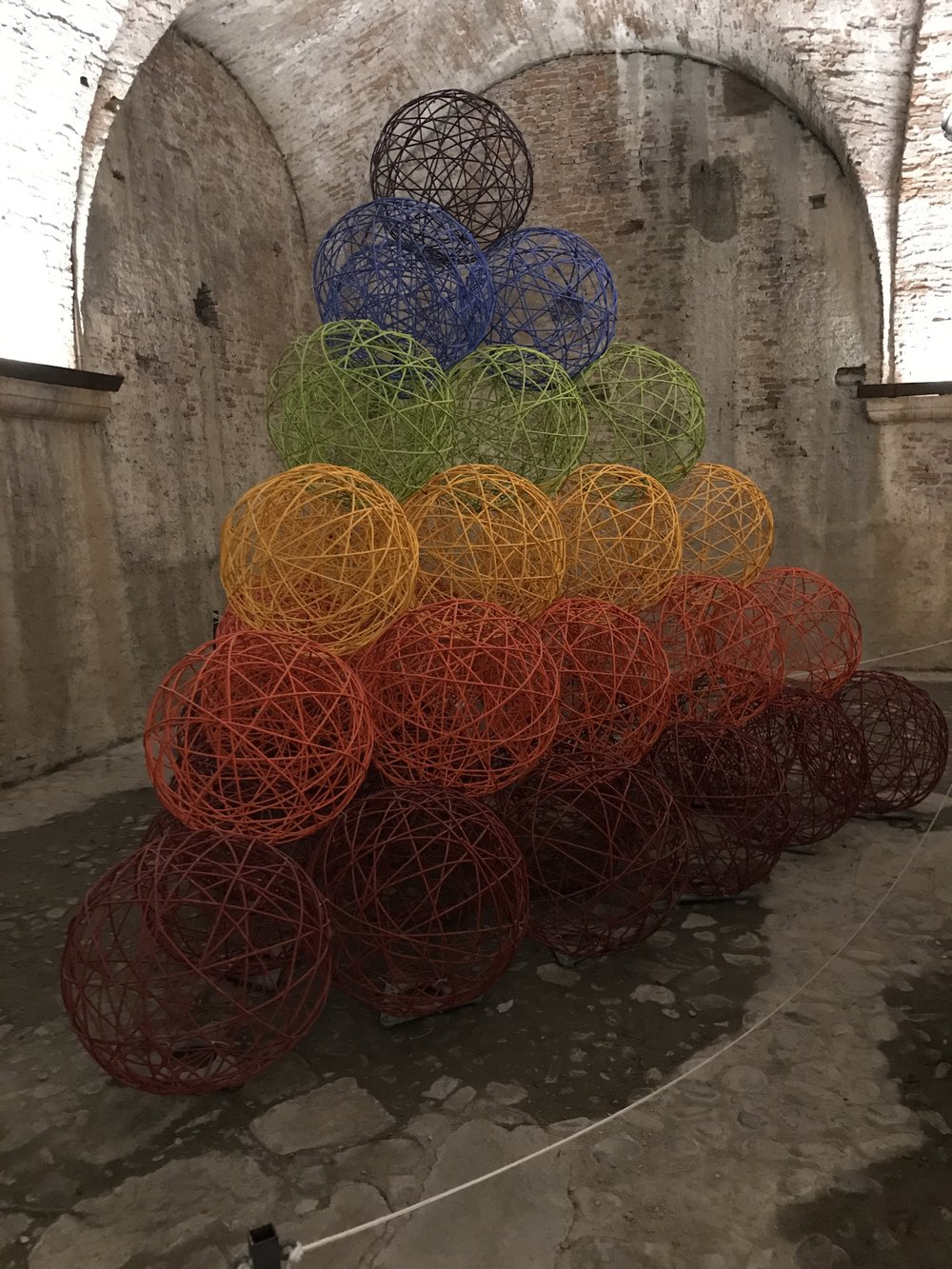 Yes, these colorful spheres are made of paper. According to one guide, they represent the cannon balls that were once stored here.