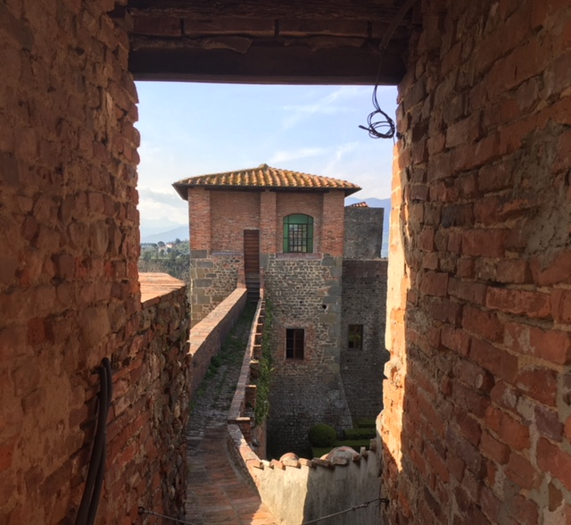 Looking out from the entry to the Torre delle Gobbine toward one of the towers in the oldest part of the fortezza.
