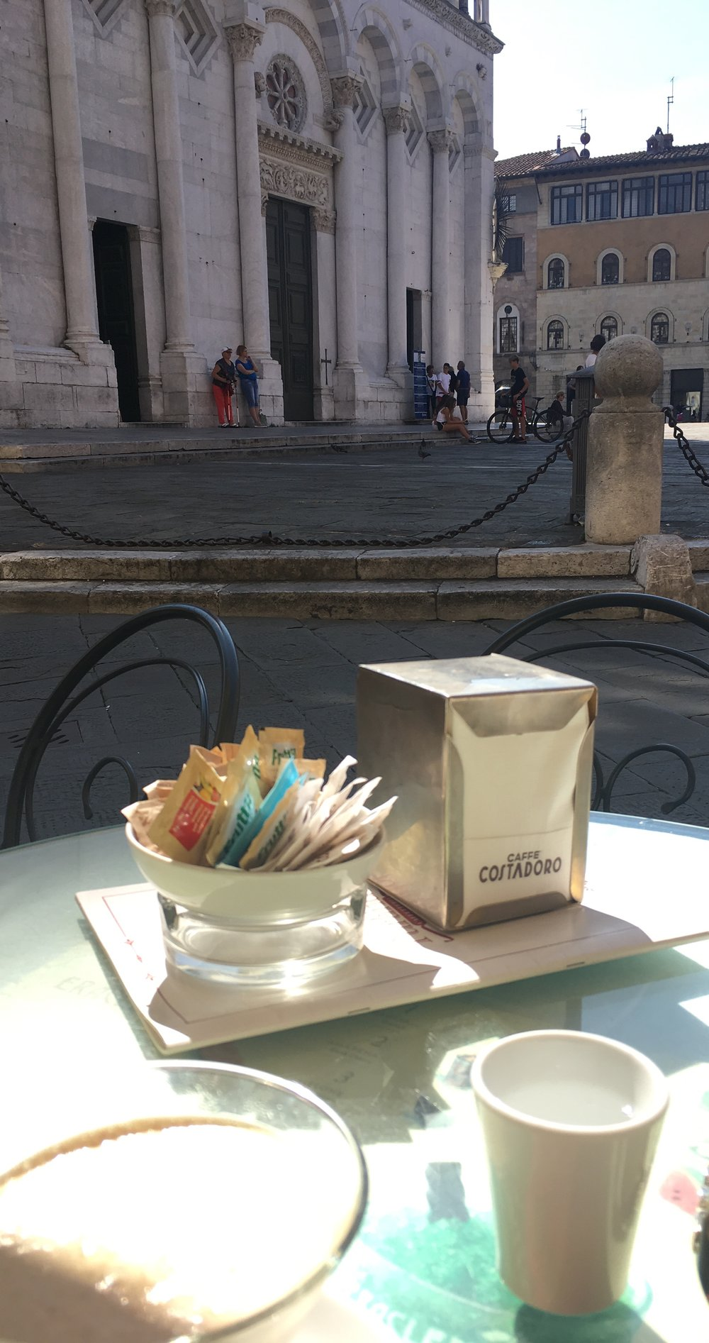 Sipping iced coffee on Piazza San Michele, Lucca