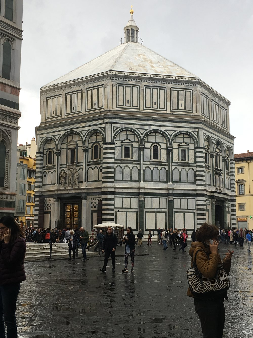 The baptistry under gray skies and rain