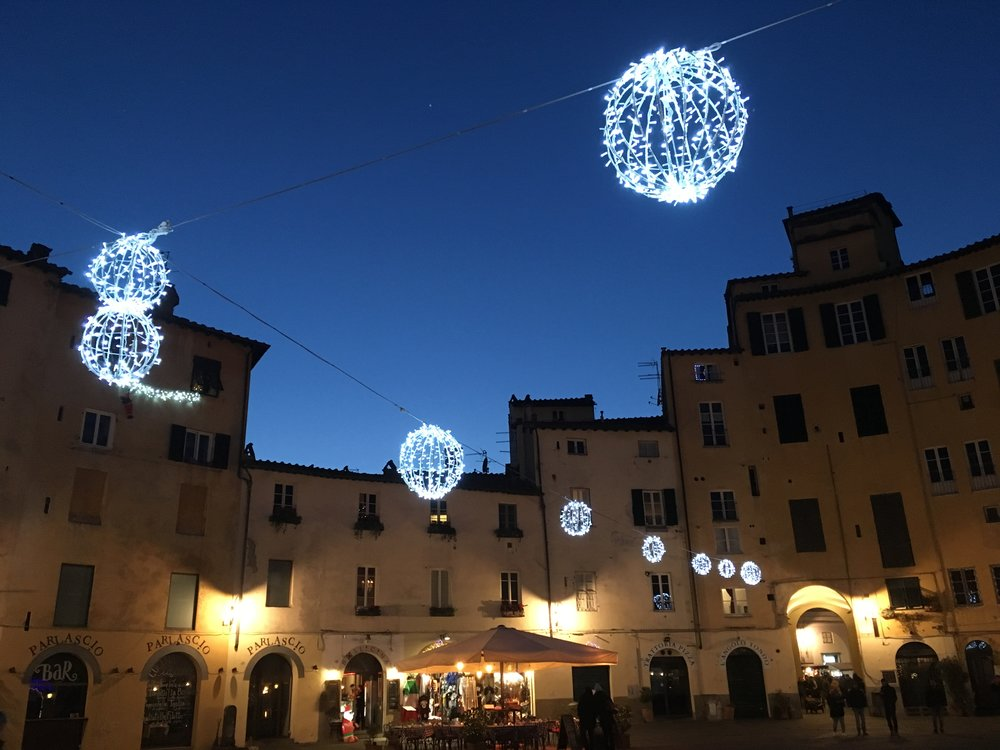 Lucca's Piazza Anfiteatro at night