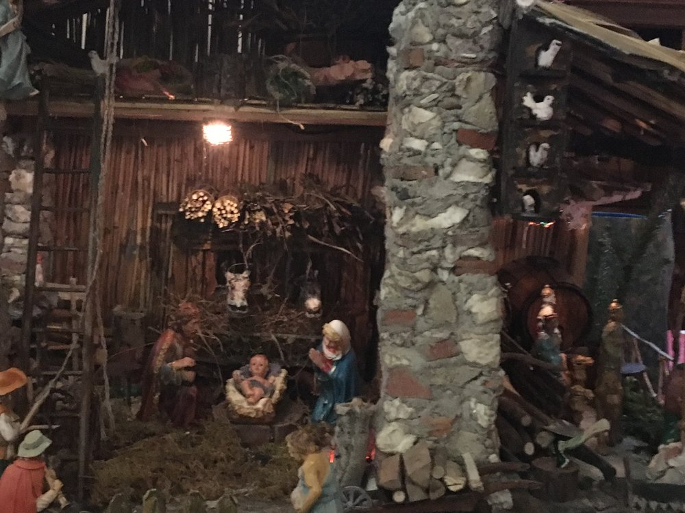 This Nativity, set in a rustic barn, includes cows, chickens and farm workers along with the holy family.