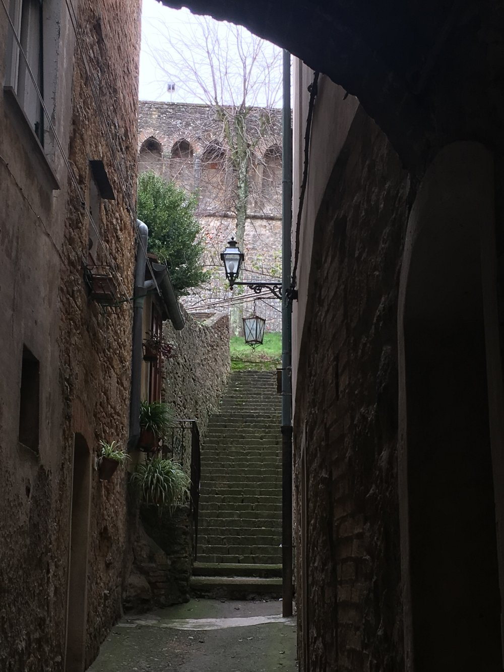 A small vicolo with steep stairs heading to the castello