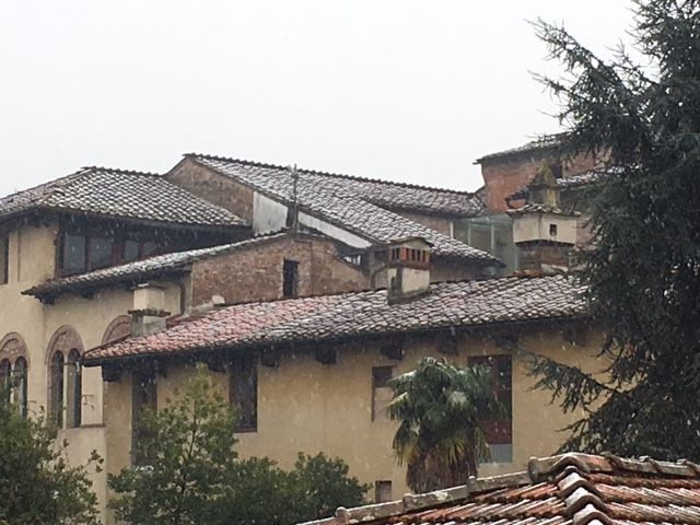 A view of snow-dusted tile roofs from my terrace.