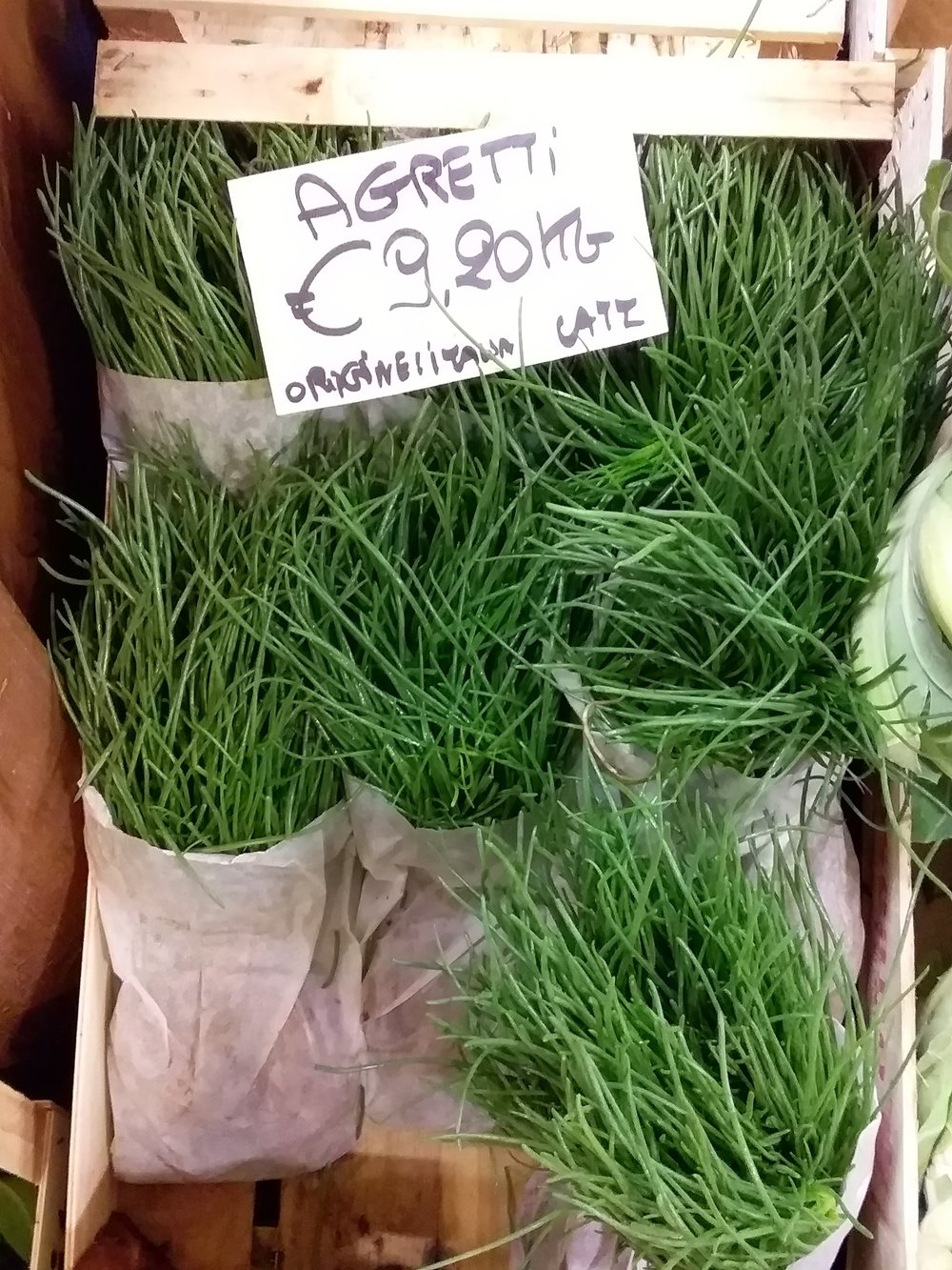 Agretti for sale in the ortofrutta