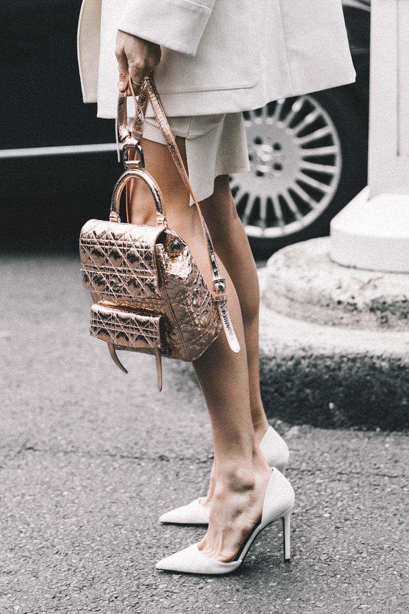 Rose gold backpack at Paris Fashion Week. Source