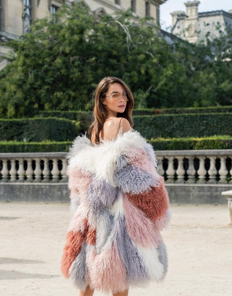 View photo source.    We adore Johanna's playful and classic style, and she's never afraid to make a statement. The unexpected color combo of her voluminous coat make it look extra decadent.