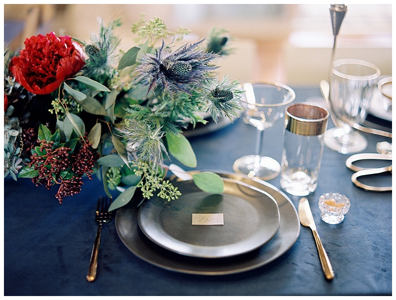 Holiday-table-inspiration-blue-velvet-tablecloth-red-peony-cocoa-plates.jpg
