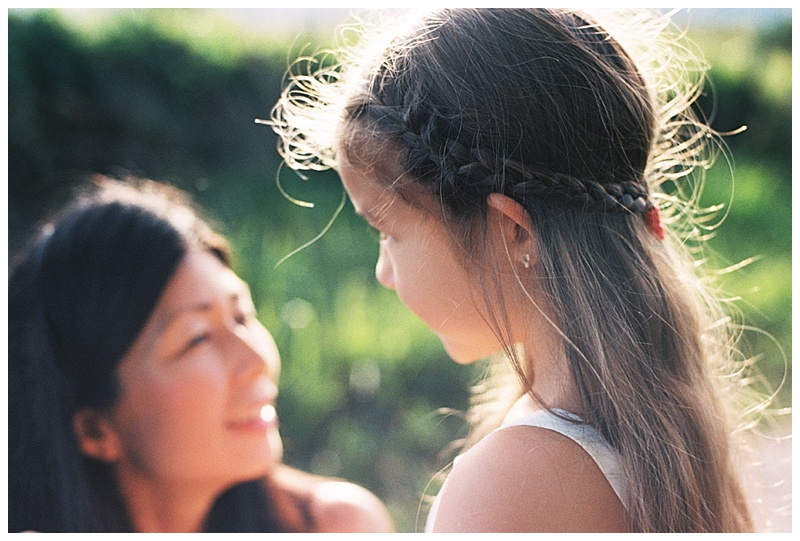 family-photographer-mom-daughter-little-girl-braided-hair.jpg