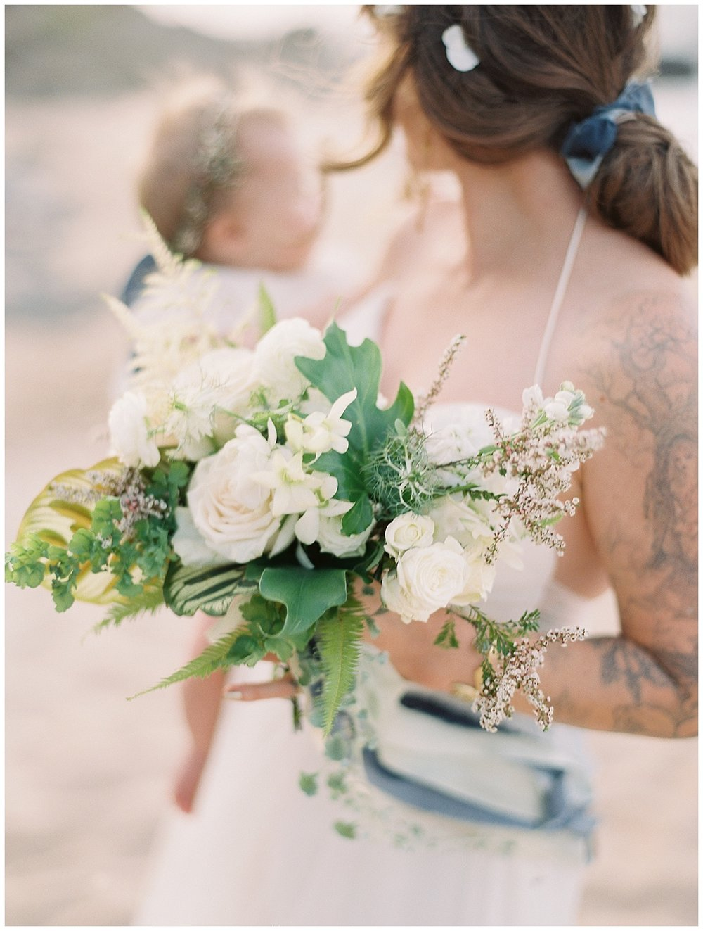 beach-elopement-bride-baby-girl-white-flower-bouquet.jpg