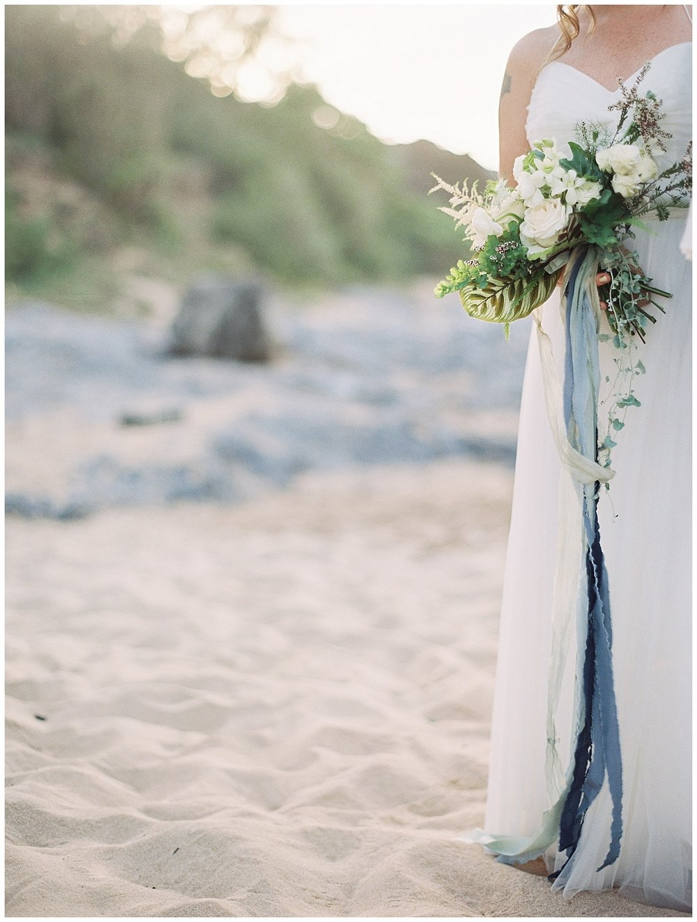 beach-elopement-bride-dress-white-bouquet-blue-ribbon.jpg