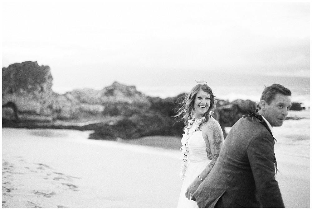 beach-elopement-bride-groom-black-and-white-candid-bride-smiling.jpg