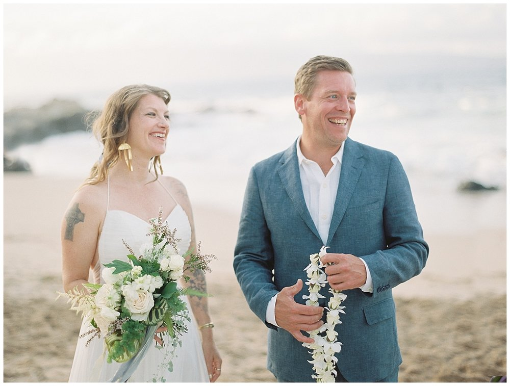 beach-elopement-bride-groom-blue-suit-laughing.jpg