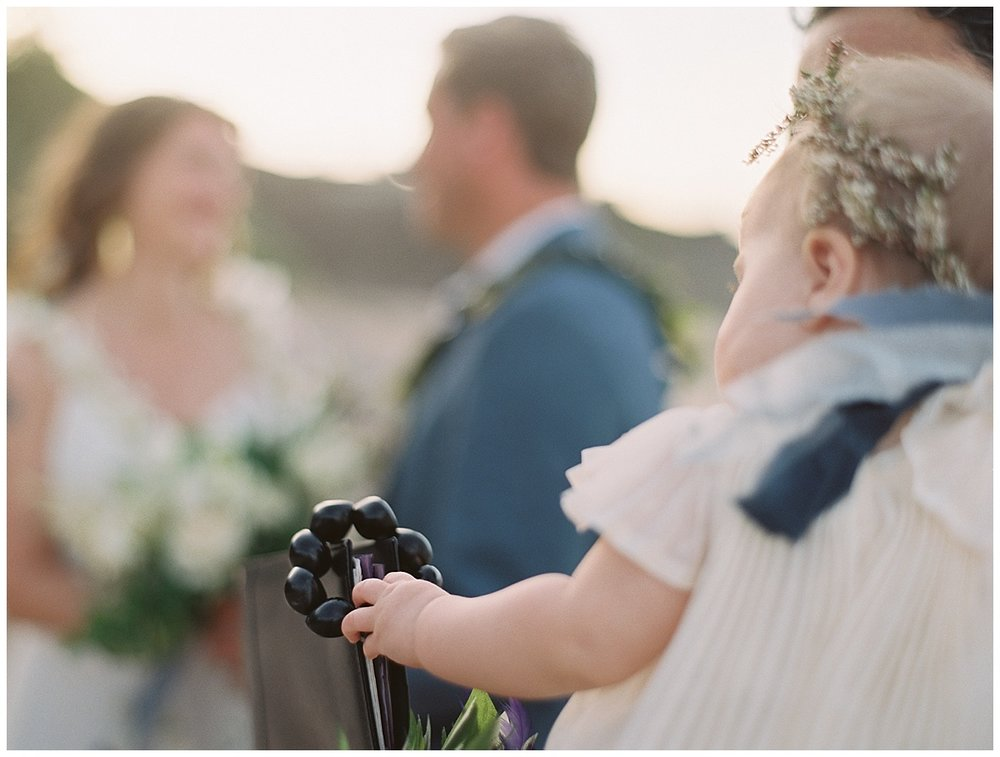 beach-elopement-bride-groom-ceremony-baby-girl-watching.jpg