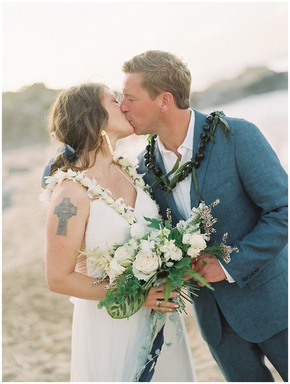 beach-elopement-bride-groom-ceremony-first-kiss.jpg