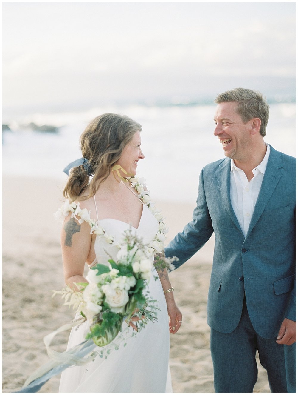 beach-elopement-bride-groom-laughing-together.jpg