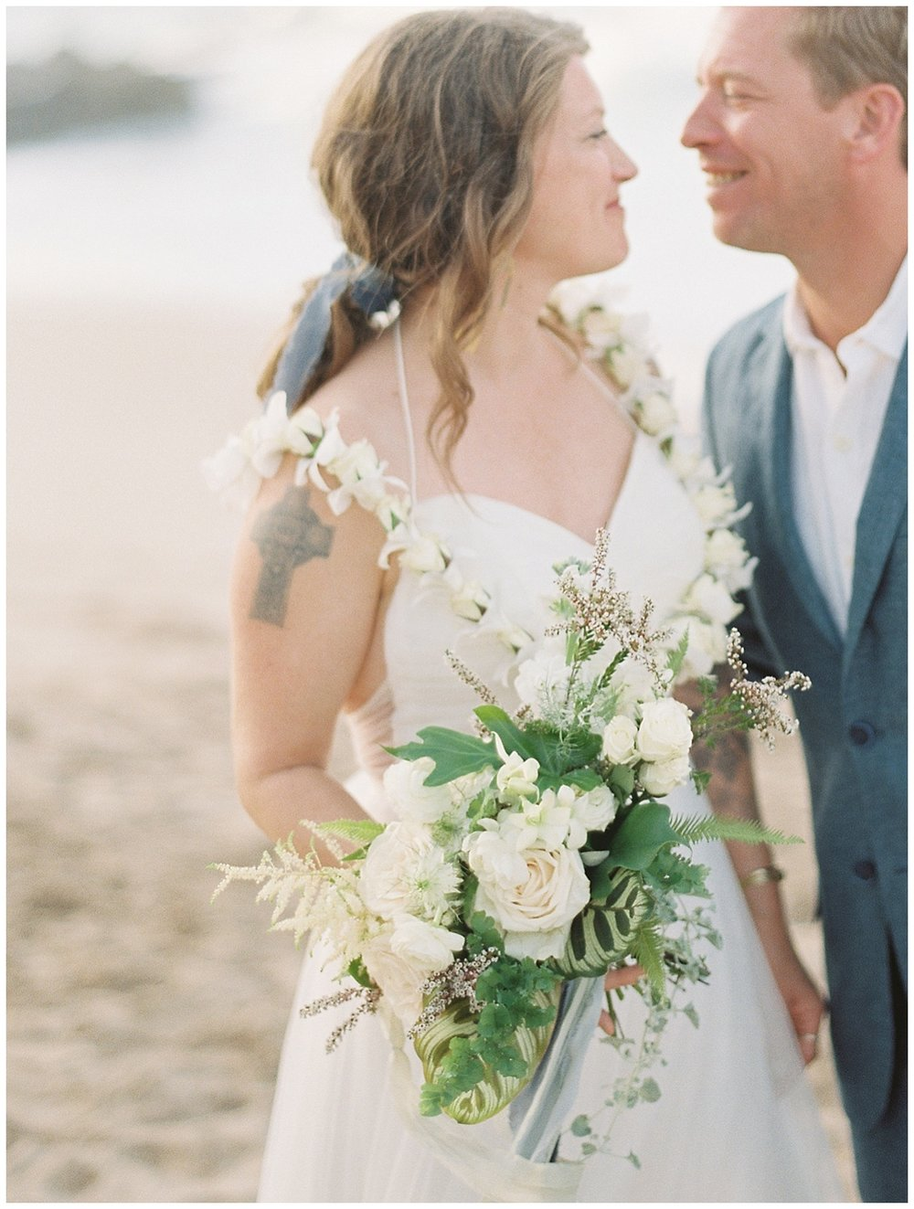 beach-elopement-bride-groom-looking-and-smiling-at-each-other.jpg