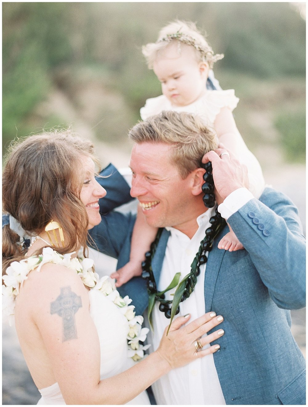 beach-elopement-bride-groom-smiling-laughing-daughter-on-shoulders-family.jpg