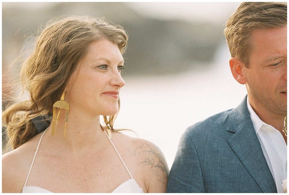 beach-elopement-bride-hair-blowing-smiling.jpg