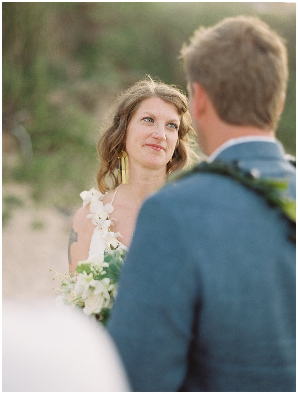 beach-elopement-bride-looking-at-groom-ceremony.jpg