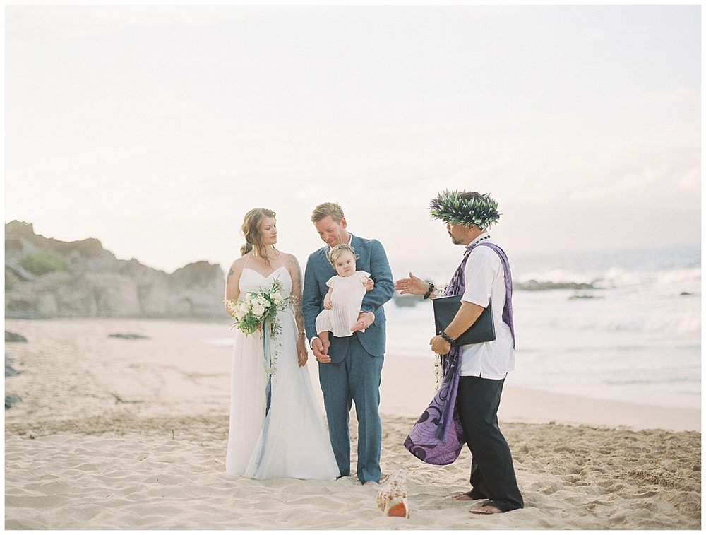 beach-elopement-ceremony-on-beach-rocks-water-conch-shell.jpg