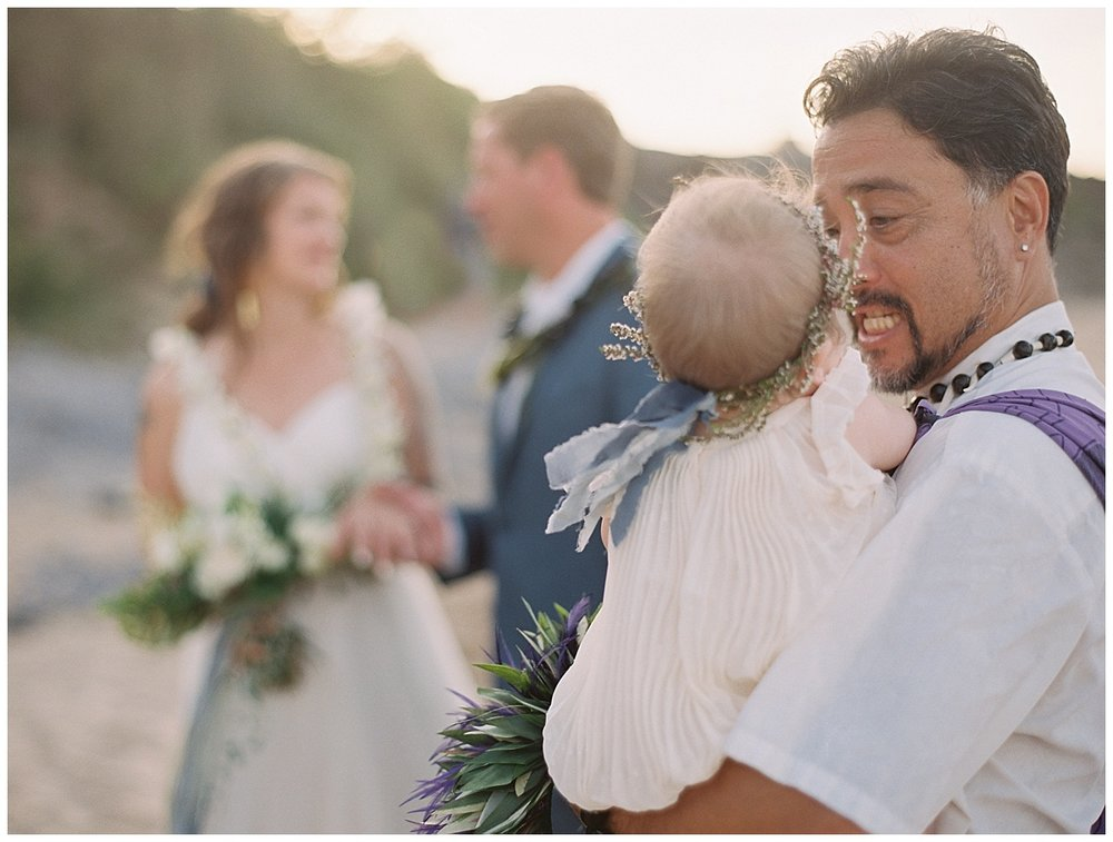 beach-elopement-flower-girl-baby-with-officiant.jpg