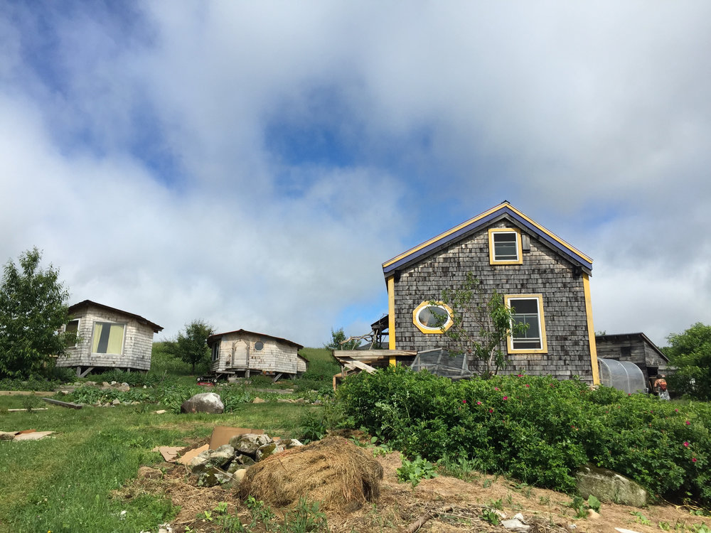 Several buildings comprise Many Hands Farm, but the main home (on the right) is where the family resides.