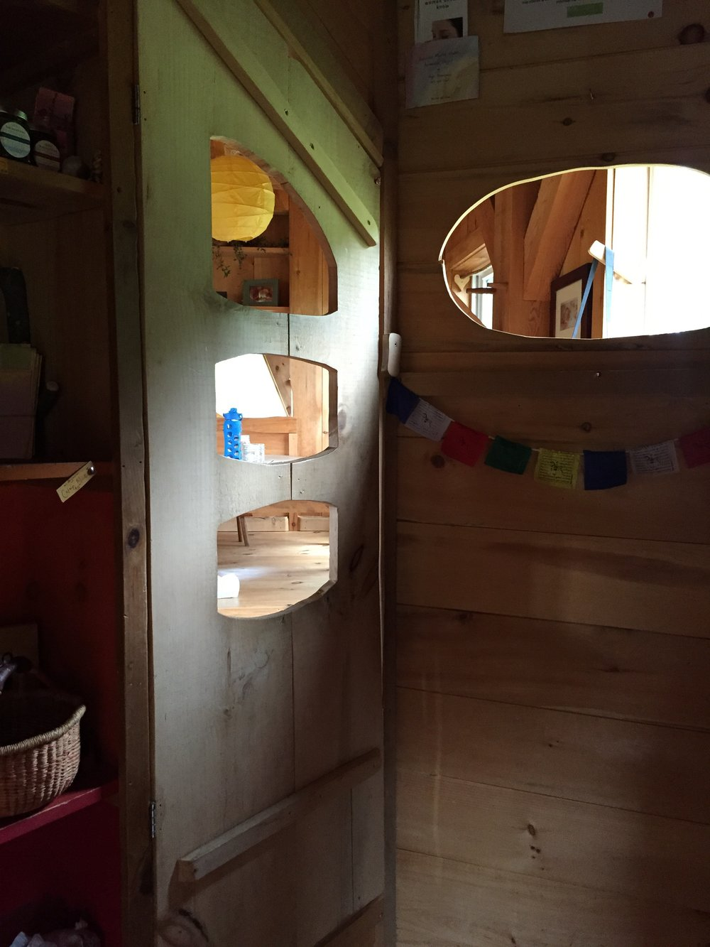 The foyer to the main house at Many Hands Farm is the place for shoes and where the family lists prices for eggs and goat's milk and other items they offer for sale or barter.