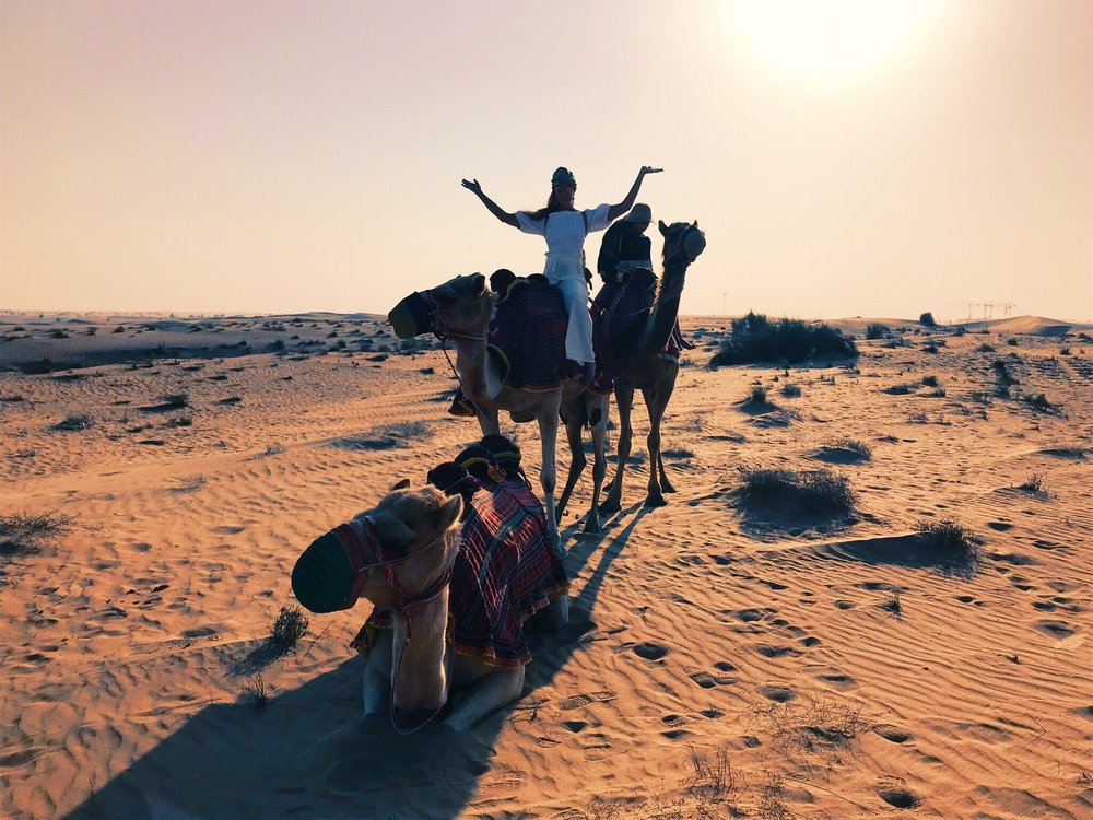 visions of dubai - playing, sweating & camel riding