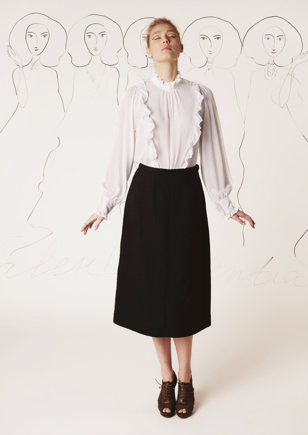 Batiste blouse with ruffles and silk-lined tweed midi skirt