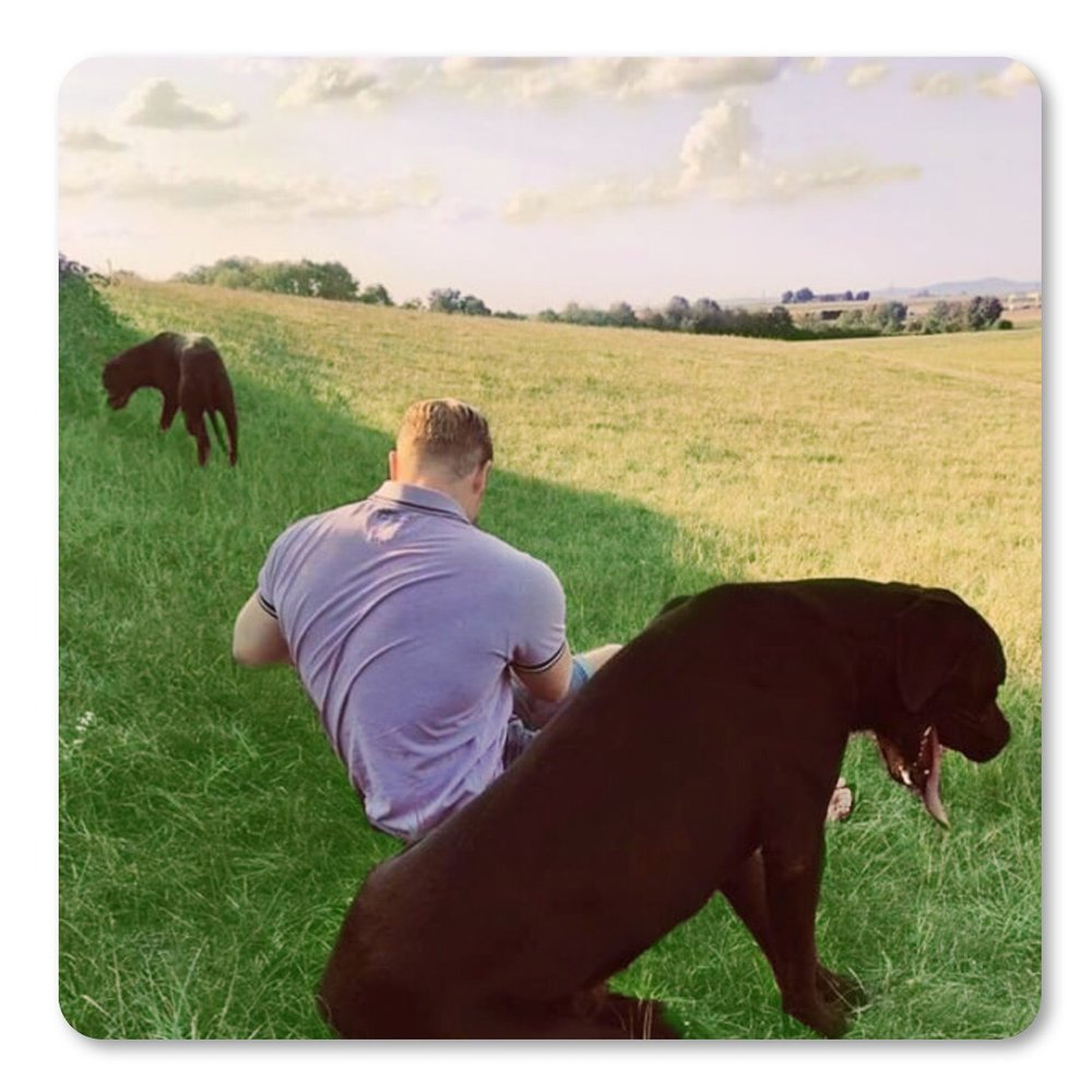 Mark and his two dogs, Rocky and Balu.