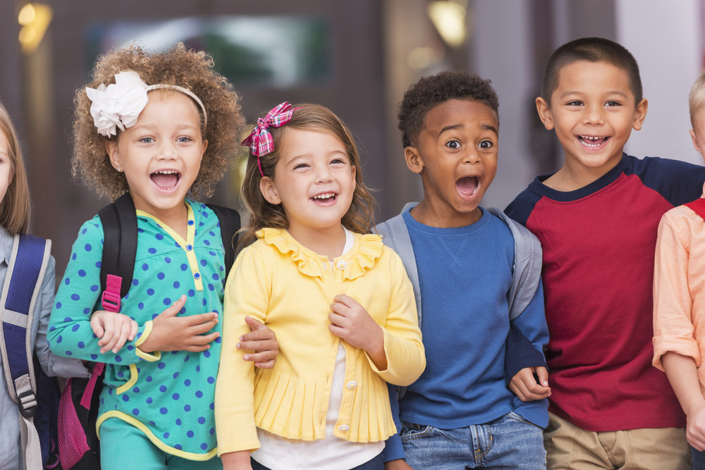 Multiracial-group-of-children-in-preschool-hallway-483277718_1256x838.jpeg