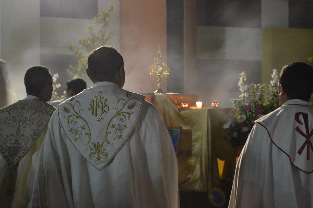 Clergy celebrating Eucharistic Adoration