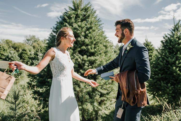 Cassidy & Isaac - Married - Nathaniel Jensen Photography - Omaha Nebraska Wedding Photograper - Nordstroms Christmas Tree Farm-11.jpg