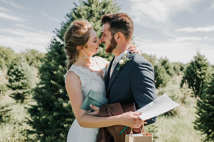 Cassidy & Isaac - Married - Nathaniel Jensen Photography - Omaha Nebraska Wedding Photograper - Nordstroms Christmas Tree Farm-13.jpg