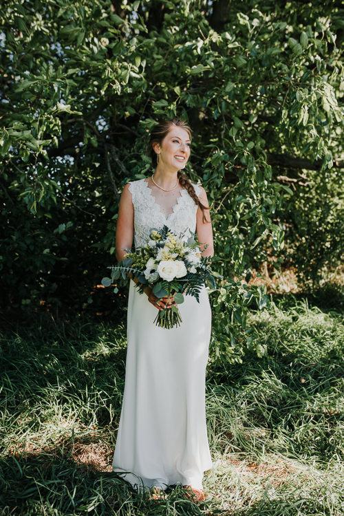 Cassidy & Isaac - Married - Nathaniel Jensen Photography - Omaha Nebraska Wedding Photograper - Nordstroms Christmas Tree Farm-73.jpg