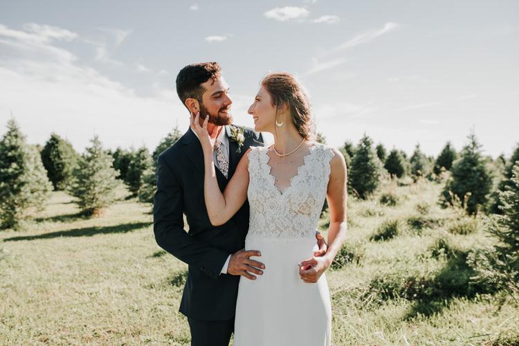 Cassidy & Isaac - Married - Nathaniel Jensen Photography - Omaha Nebraska Wedding Photograper - Nordstroms Christmas Tree Farm-153.jpg