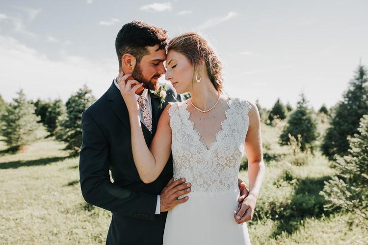 Cassidy & Isaac - Married - Nathaniel Jensen Photography - Omaha Nebraska Wedding Photograper - Nordstroms Christmas Tree Farm-154.jpg