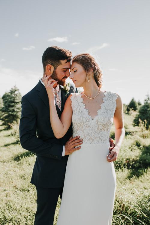 Cassidy & Isaac - Married - Nathaniel Jensen Photography - Omaha Nebraska Wedding Photograper - Nordstroms Christmas Tree Farm-155.jpg