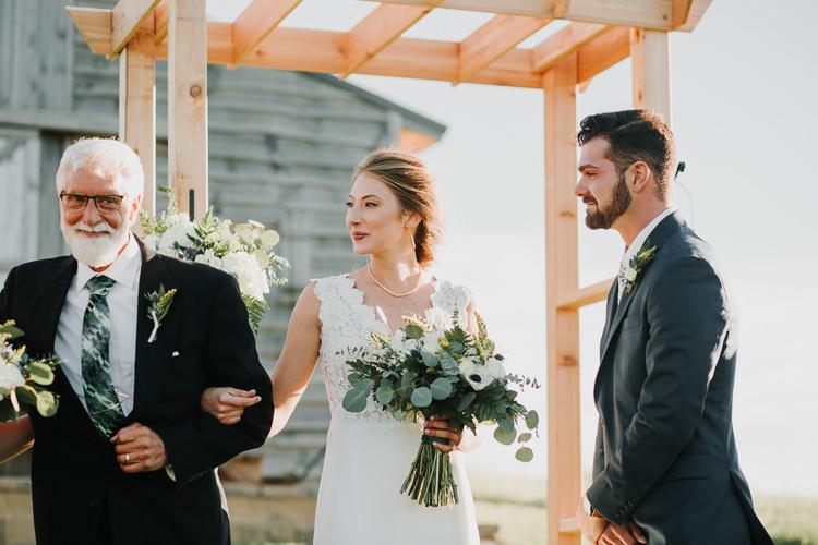 Cassidy & Isaac - Married - Nathaniel Jensen Photography - Omaha Nebraska Wedding Photograper - Nordstroms Christmas Tree Farm-276.jpg