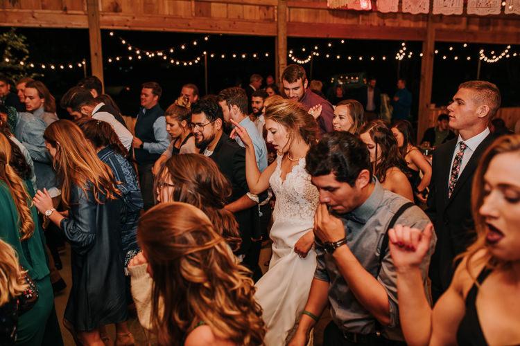 Cassidy & Isaac - Married - Nathaniel Jensen Photography - Omaha Nebraska Wedding Photograper - Nordstroms Christmas Tree Farm-465.jpg