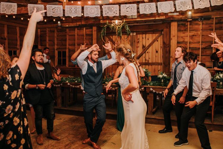 Cassidy & Isaac - Married - Nathaniel Jensen Photography - Omaha Nebraska Wedding Photograper - Nordstroms Christmas Tree Farm-483.jpg