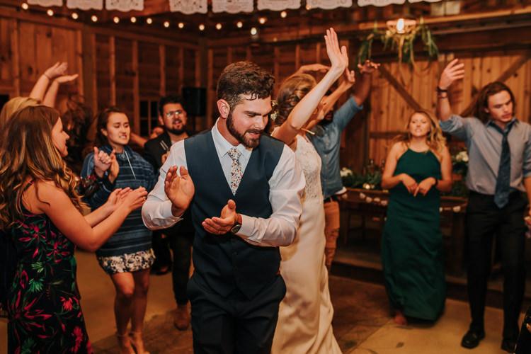 Cassidy & Isaac - Married - Nathaniel Jensen Photography - Omaha Nebraska Wedding Photograper - Nordstroms Christmas Tree Farm-484.jpg