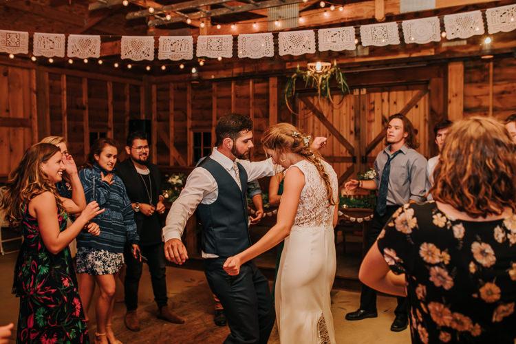 Cassidy & Isaac - Married - Nathaniel Jensen Photography - Omaha Nebraska Wedding Photograper - Nordstroms Christmas Tree Farm-485.jpg