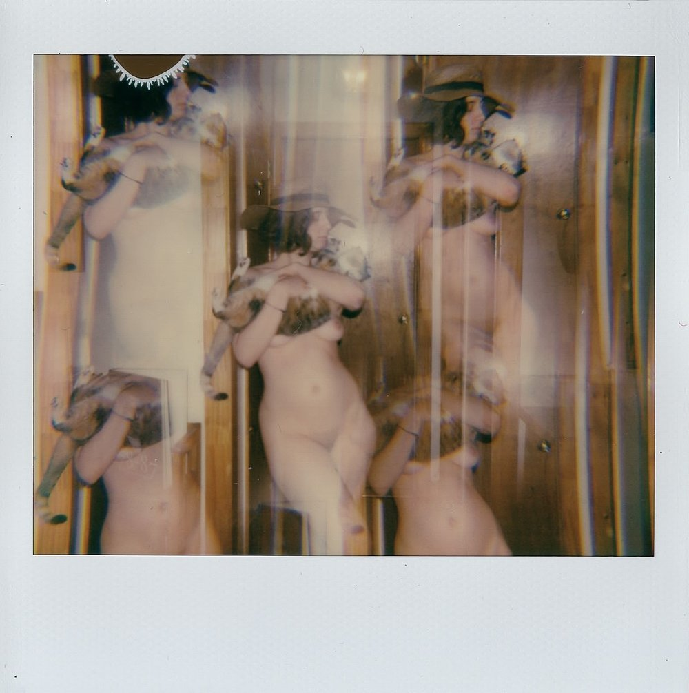 My sister and our kitty Lolita in Brooklyn, NY -- Polaroid Spectra -- February 2017