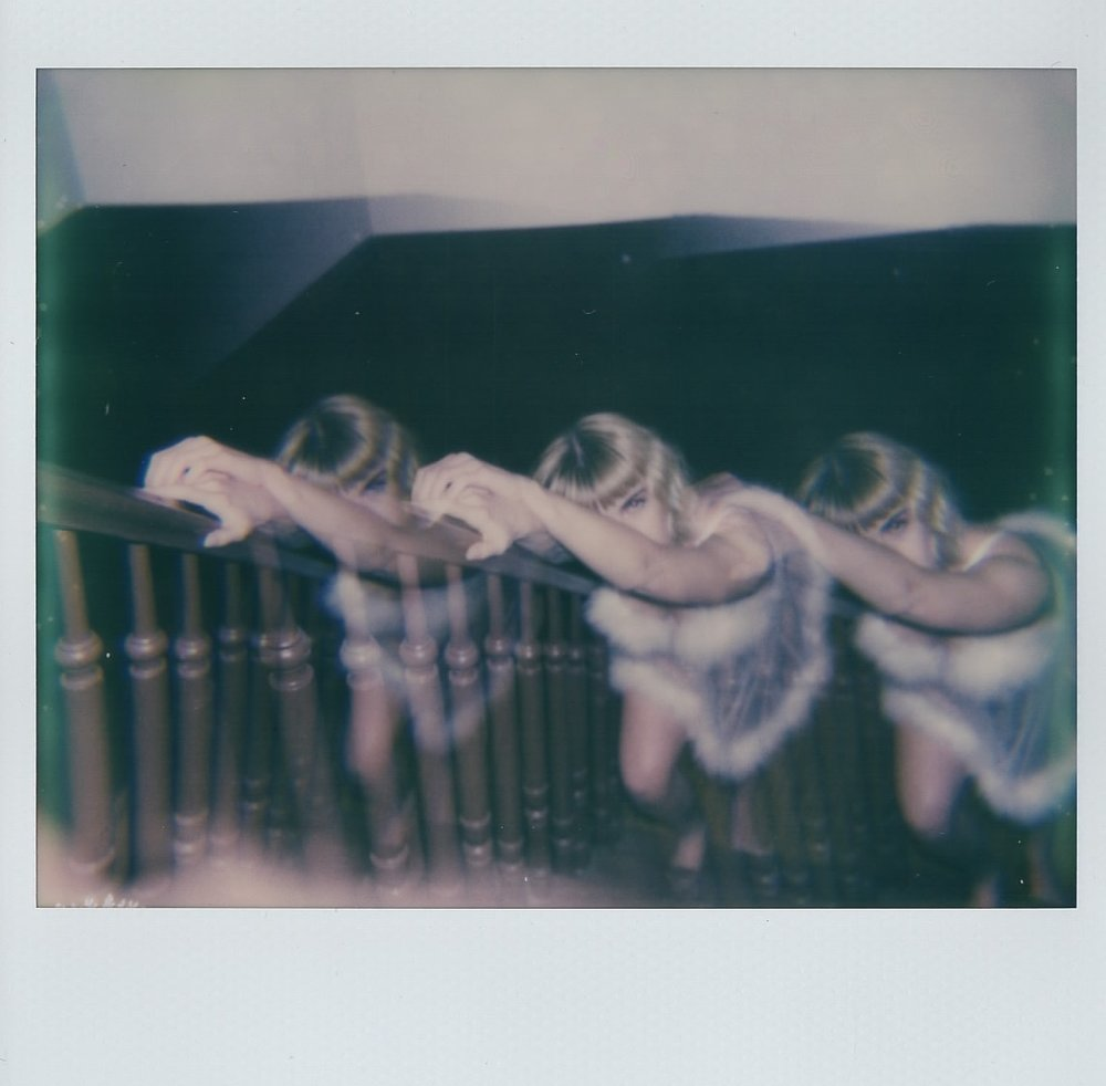Caitlin Hales in my apartment building-- Brooklyn, NY -- February 2017 -- Polaroid Spectra using Impossible Project Film -- Wearing vintage Frederick's of Hollywood