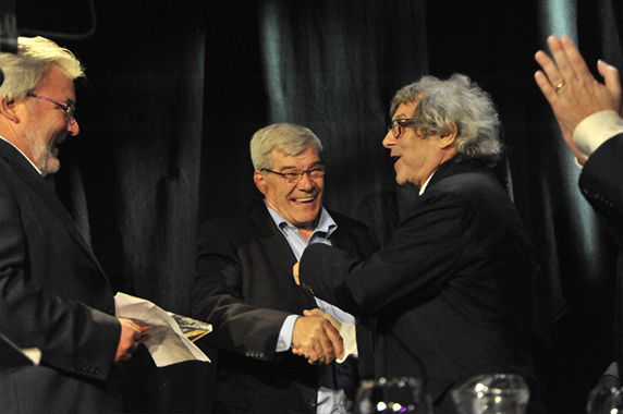 Supermac presents the award to Ian and Dick.
