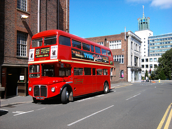 The very handsome AEC Routemaster, our first proper bus for the use of, seen parked outside the City Hall stage door.