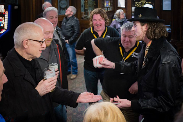 Magician extraordinaire Chris Cross spellbinds passengers and crew during a refreshment stop at the Bridge Hotel.